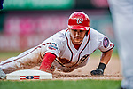 1 August 2018: Washington Nationals shortstop Trea Turner dives safely back to first during a game against the New York Mets at Nationals Park in Washington, DC. The Nationals defeated the Mets 5-3 to sweep the 2-game weekday series. Mandatory Credit: Ed Wolfstein Photo *** RAW (NEF) Image File Available ***
