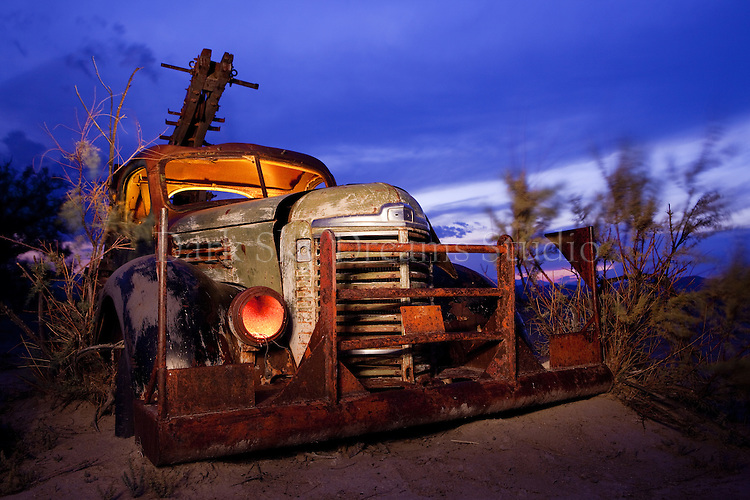 Nocturnal view of J. Pinkerton vintage company truck and water well drilling rig abandoned in the desert at Capitol Reef National Park, Utah