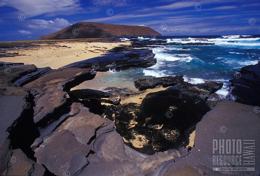 Niihau Coastline. Pristine natural coast, white sand beaches,  reefs, and clear blue water.