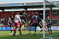 Medy Elito of Cambridge United heads clear during Stevenage vs Cambridge United, Sky Bet EFL League 2 Football at the Lamex Stadium on 14th April 2018