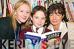 Family fun: Ballybunion librarian Sharon Sheehan with Cormac and Peggy Linnane, Ballybunion at the shared reading afternoon at Ballybunion library on Thursday, December 20th.   Copyright Kerry's Eye 2008