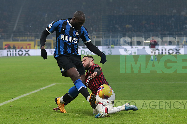 Theo Hernandez of AC Milan challenges Romelu Lukaku of Inter as he crosses the ball during the Serie A match at Giuseppe Meazza, Milan. Picture date: 9th February 2020. Picture credit should read: Jonathan Moscrop/Sportimage
