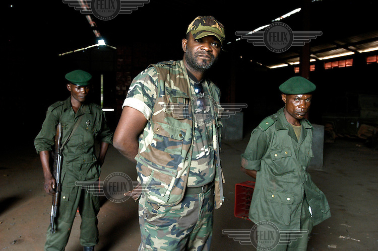 Major John Irung Tshingud, commander of the Congolese Armed forces (FARDC) Intervention Brigade in a depot containing munitions and weapons stockpiles stored by the FARDC in an abandoned Coca Cola factory in Equateur Province..