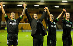 Colin Calderwood cel;ebrates with the HIbs players to the travelling fans