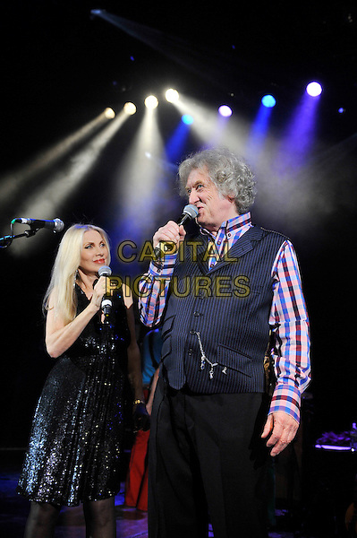 Singer / songwriter Lynsey De Paul has died at the age 64 following suspected brain haemorrhage. She represented the UK in the 1977 Eurovision Song Contest and was best known for her hits Sugar Me and Won't Somebody Dance With Me.<br /> STOCK PHOTO: Lynsey de Paul and Noddy Holder <br /> performing for Marc Bolan's 35th anniversary concert in aid of the PRS for Music Members Benevolent Fund, Shepherd's Bush Empire, London, England. <br /> 15th September 2012<br /> on stage in concert live gig performance performing music half length black dress waistcoat singing check shirt blue <br /> CAP/MAR<br /> &copy; Martin Harris/Capital Pictures