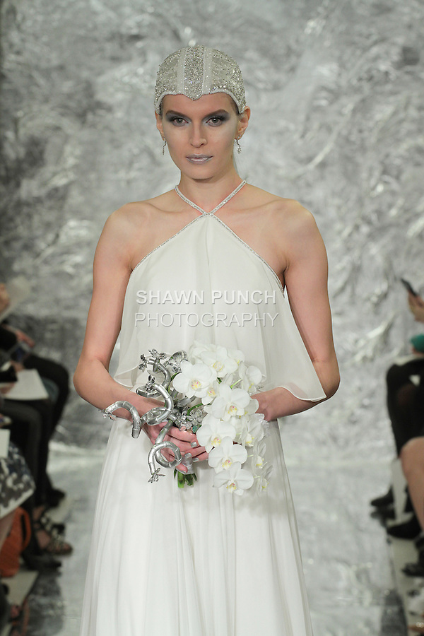 Model Irina Kondratyeva walks runway in Leia - a white silk chiffon halter bridal gown with ruffle, from the Theia Spring 2017 bridal collection by Don O'Neill, during New York Bridal Fashion Week Spring Summer 2017 on April 14, 2016.