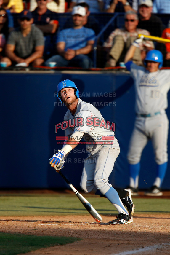 Eric Filia #4 of the UCLA Bruins bats against the Cal State Fullerton Titans during the NCAA Super Regional at Goodwin Field on June 7, 2013 in Fullerton, California. UCLA defeated Cal State Fullerton, 5-3. (Larry Goren/Four Seam Images)
