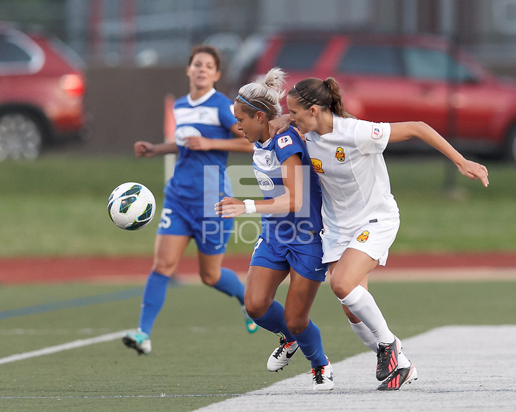 Boston Breakers substitute forward Kyah Simon (17) works to clear ball as Western New York Flash defender Katherine Reynolds (16) pressures. In a National Women's Soccer League Elite (NWSL) match, the Boston Breakers (blue) tied Western New York Flash (white), 2-2, at Dilboy Stadium on June 5, 2013.