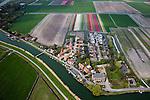 Nederland, Noord-Holland, Gemeente Koggenland, 28-04-2010; Oudendijk, de dijk, Beetskoogkade of Beemster uitwatering, maakt deel uit van de Westfriese Omringdijk. Boven in beeld bollenvelden in de polder Beschoot..luchtfoto (toeslag), aerial photo (additional fee required).foto/photo Siebe Swart