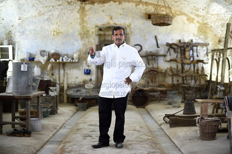 Machindra Kasture, Chef to the President of the Republic of India, poses for a portrait in the Cascina Colombara during the annual meeting of the Club des Chefs des Chefs in Livorno Ferraris, Vercelli, Italy, July 18, 2015.<br /> The Club des Chefs des Chefs, which is seen as the world's most exclusive gastronomic society, has extremely strict membership criteria: to be accepted into this highly elite club, you need to be the current personal chef of a head of state. If he or she does not have a personal chef, members can be the executive chef of the venue that hosts official State receptions. One of the society's primary purposes is to promote major culinary traditions and to protect the origins of each national cuisine. The Club des Chefs des Chefs also aims to develop friendship and cooperation between its members, who have similar responsibilities in their respective countries. <br /> The annual meeting of the Club has been hosted this year in the production site of the Italian rice company called Riso Acquerello. <br /> © Giorgio Perottino