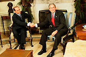 United States President George W. Bush greets Prime Minister Silvio Berlusconi of Italy for a photo-op inside the Oval Office of the White House in Washington, D.C. on December 15, 2004.<br /> Credit: Jay L. Clendenin / Pool via CNP