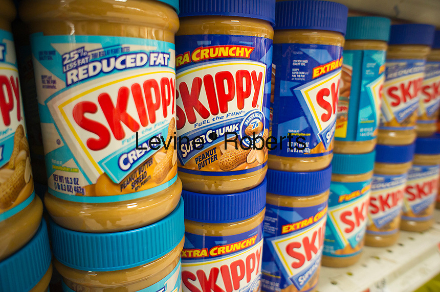 Jars of Skippy  peanut butter are seen on a supermarket shelf in New York on Saturday, October 6, 2012. Unilever, the owner of the Skippy brand, is considering selling the US and Canadian businesses of the iconic peanut butter. (© Richard B. Levine)