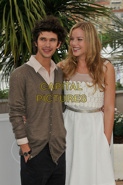 BEN WISHAW & ABBIE CORNISH.'Bright Star' photocall.62nd International Cannes Film Festival.Cannes, France. 15th May 2009.half length white dress silver belt circles grey gray trousers brown cardigan hand in pocket whishaw.CAP/PL.©Phil Loftus/Capital Pictures