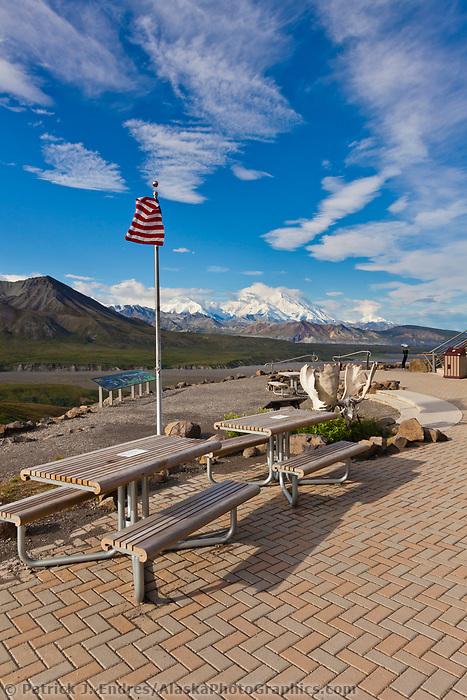 The American flag flies at Eielson Visitor's center with the Summit of Denali visible in the distance, Denali National Park, Interior, Alaska.