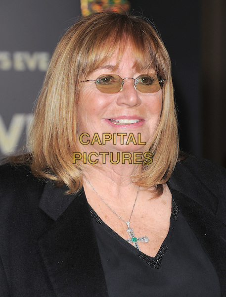 "Penny Marshall.The World Premiere of ""New Year's Eve' held at The Grauman's Chinese Theatre in Hollywood, California, USA..December 5th, 2011.headshot portrait black tinted glasses.CAP/RKE/DVS.©DVS/RockinExposures/Capital Pictures."