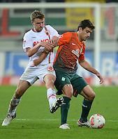 FUSSBALL   1. BUNDESLIGA  SAISON 2012/2013   7. Spieltag FC Augsburg - Werder Bremen          05.10.2012 Stephan Hain (li, FC Augsburg) gegen Sokratis Papastathopoulos (SV Werder Bremen)