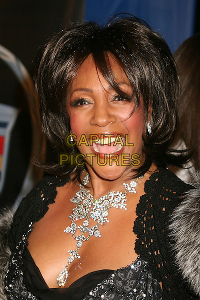 "MARY WILSON.Los Angeles Premiere of ""Dreamgirls"" at the Wilshire Theatre, Beverly Hills, California, USA. .December 11th, 2006.headshot portrait flower diamond necklace mouth open .CAP/ADM/BP.©Byron Purvis/AdMedia/Capital Pictures"