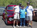 L-r:  Reggie Banks, Calvin Fisk and Otys Banks in front of Fisk's 1953 candy brandywine red Ford pickup during the Hot August Nights Pre-Kickoff show and shine held at the Bonanza Casino in Reno, Nevada on Sunday, August 4, 2013.