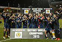 The Scotland team celebrate after  beating England 1-0 at Starks Park, Kirkcaldy to win the Victory Shield.