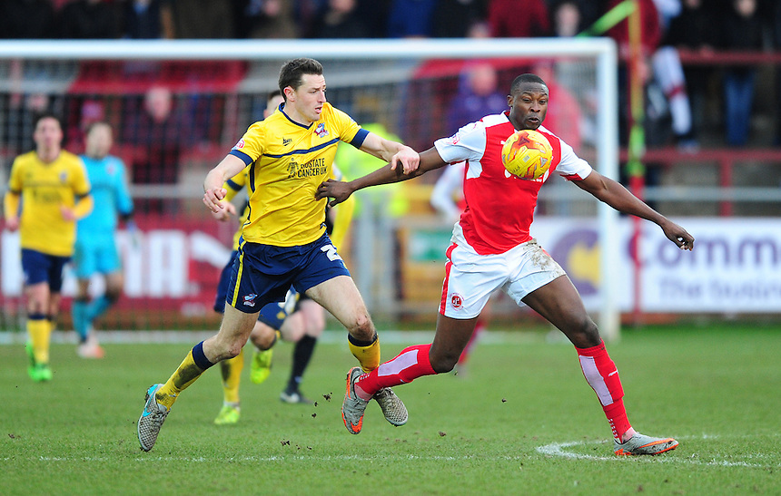 Fleetwood Town&rsquo;s Shola Ameobi shields the ball from Scunthorpe United&rsquo;s Murray Wallace<br /> <br /> Photographer Chris Vaughan/CameraSport<br /> <br /> Football - The Football League Sky Bet League One - Fleetwood Town v Scunthorpe United  - Saturday 20th February 2016 - Highbury Stadium - Fleetwood    <br /> <br /> &copy; CameraSport - 43 Linden Ave. Countesthorpe. Leicester. England. LE8 5PG - Tel: +44 (0) 116 277 4147 - admin@camerasport.com - www.camerasport.com