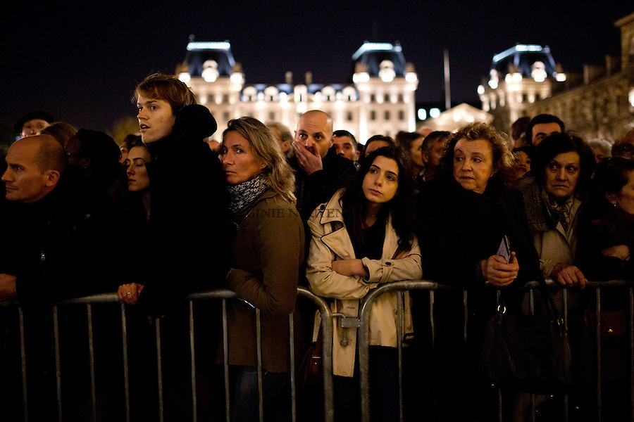 PARIS, FRANCE - NOVEMBER 15: Thousands of people were lining up and waiting for a mess for the victims at the cathedral Notre Dame on November 15,2015. The attacks of the 13th of November killed 129 people in Paris and injured 352 .