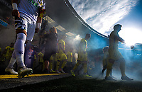 The teams walk out for the A-League football match between Wellington Phoenix and Central Coast Mariners at Westpac Stadium in Wellington, New Zealand on Saturday, 4 January 2020. Photo: Dave Lintott / lintottphoto.co.nz