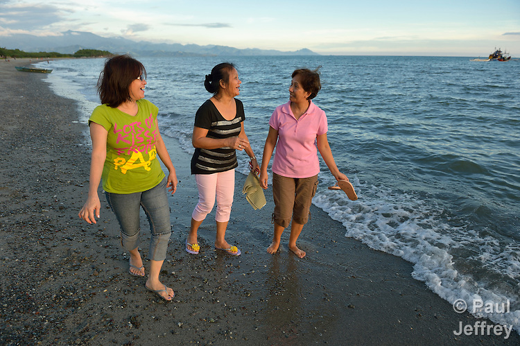 Francia Nemia Kikuchi (left), Erlinda Francisco and Carmela Anteza are members of Batis Aware, a group of women, most of whom are survivors of human trafficking, which works to provide support and education to Filipina women caught up in trafficking or vulnerable to exploitation by traffickers. Here they walk along the beach in Lupon, a small town on the southern island of Mindanao.