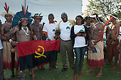 Angolan delegation members pose for a photowith their national flag together with a group of Xukuru Kariri indigenous people from brazil at the People's Summit, United Nations Conference on Sustainable Development (Rio+20), Rio de Janeiro, Brazil, 15th June 2012. Photo © Sue Cunningham.