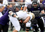 SIOUX FALLS, SD - OCTOBER 18: Cameron Ostrom #32 and Evan Gentry #69 from the University of Sioux Falls bring down Tyler Tonderum #22 from Southwest Minnesota State in the first half of their game Saturday afternoon at Bob Young Field in Sioux Falls. (Photo by Dave Eggen/Inertia)