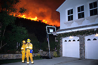 870000319 la county firemen work to protect private homes in agoura as the topanga wildfire flares up on a nearby ridge in los angeles county california