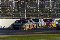 14 February, 2010, Daytona Beach, Florida USA USA.Martin Truex,Jr. (#56) leads the field up the back straight..©F. Peirce Williams 2010 USA.