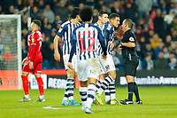 29th December 2019; The Hawthorns, West Bromwich, West Midlands, England; English Championship Football, West Bromwich Albion versus Middlesbrough; Jake Livermore of West Bromwich Albion confronts Referee Geoff Eltringham after a contentious decision - Strictly Editorial Use Only. No use with unauthorized audio, video, data, fixture lists, club/league logos or 'live' services. Online in-match use limited to 120 images, no video emulation. No use in betting, games or single club/league/player publications