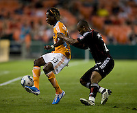 Julius James (2) of DC United stays close to Joseph Ngwenya (33) of the Houston Dynamo during their game at RFK Stadium in Washington, DC.  Houston defeated D.C. United, 3-1.