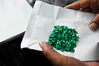 Rough emeralds seen before being processed in a cutting and polishing workshop in Bogota, Colombia, 31 January 2013. Approximately 60 percent of the world's total amount of emeralds come from Colombia. Most of the rough gems are processed in workshops located in the emerald district in downtown Bogota. Due to their special clarity and deep vivid green color, Colombian gemstones are considered the most beautiful emeralds in the world.