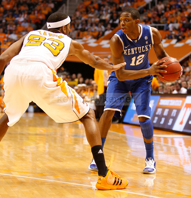 Brandon Knight looks for an open teammate while being guarded by Tennessee's Cameron Tatum, at Thompson-Boling Arena, on Sunday, March 6, 2011. Photo by Latara Appleby | Staff
