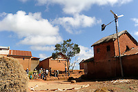 MADAGASCAR village Morarano with smal wind turbine for rural off-grid electrification / MADAGASKAR , Dorf Morarano mit kleiner Windkraftanlage zur laendlichen Elektrifizierung