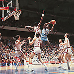 28 MAR 1981:  North Carolina forward James Worthy (52) and Virginia center Ralph Sampson (50) during the NCAA Men's National Basketball Final Four semifinal game held in Philadelphia, PA, at the Spectrum. North Carolina defeated Virginia 78-65 to meet Indiana for the title. Also pictured Virginia forward Terry Gates (44), guard Jeff Lamp (3), guard Othell Wilson (11) and guard Jeff Jones (24). Photo by Rich Clarkson/NCAA Photos.SI CD 0022-42