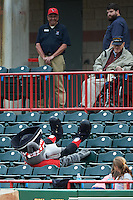 Erie SeaWolves mascot SeaWolf gets stuck in some seats while entertaining fans during a game against the Bowie Baysox on May 12, 2016 at Jerry Uht Park in Erie, Pennsylvania.  Bowie defeated Erie 6-5.  (Mike Janes/Four Seam Images)
