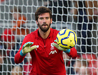 27th October 2019; Anfield, Liverpool, Merseyside, England; English Premier League Football, Liverpool versus Tottenham Hotspur; Liverpool goalkeeper Alisson stops a shot during his pre -match warm up session - Strictly Editorial Use Only. No use with unauthorized audio, video, data, fixture lists, club/league logos or 'live' services. Online in-match use limited to 120 images, no video emulation. No use in betting, games or single club/league/player publications