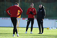 Ryan Giggs (right) Manager of Wales speaks to Paul Dummett (centre) during the Wales Training Session at The Vale Resort in Cardiff, Wales, UK. Monday 12 November 2018