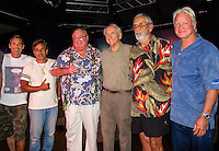 "HONOLULU, Turtle Bay Resort, North Shore, Oahu. - (Thursday, January 3, 2013) Garrett McNamara (HAW), Reno Abellira (HAW), Greg Noll (HAW), Peter Cole (USA) Kimo Hollinger (HAW) and Randy Rarick (HAW).   Greg Noll (USA) was the guest  speaker of Talk Story at Surfer The Bar tonight, Noll, nicknamed ""Da Bull"" by Phil Edwards in reference to his physique and way of ""charging"" down the face of a wave is an American pioneer of big wave surfing and is also acknowledged as a prominent longboard shaper. Noll was a member of a US lifeguard team that introduced Malibu boards to Australia around the time of the Melbourne Olympic Games. Noll became known for his exploits in large Hawaiian surf on the North Shore of Oahu. He first gained a reputation in November 1957 after surfing Waimea Bay in 25-30 ft surf when it had previously been thought impossible even to the local Hawaiians. He is perhaps best known for being the first surfer to ride a wave breaking on the outside reef at the so-called Banzai Pipeline in November 1964...It was later at Makaha, in December 1969, that he rode what many at the time believed to be the largest wave ever surfed. After that wave and the ensuing wipeout during the course of that spectacular ride down the face of a massive dark wall of water, his surfing tapered off and he closed his Hermosa Beach shop in the early 1970s. He and other surfers such as Pat Curren, Mike Stang, Buzzy Trent, George Downing, Mickey Munoz, Wally Froyseth, Fred Van Dyke and Peter Cole are viewed as the most daring surfers of their generation...Noll is readily identified in film footage while surfing by his now iconic black and white horizontally striped ""jailhouse"" boardshorts and was interviewed by host Jodi Wilmott (AUS). . Photo: joliphotos.com"