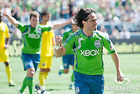 Seattle Sounders FC midfielder Mauro Rosales (10) celebrates after scoring a goal on a penalty kick in a match against Columbus Crew at CenturyLink Field in Seattle, Washington. The Sounders defeated Columbus Crew, 6-2.