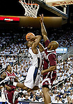 March 1, 2012: Nevada Wolf Pack gaurd Deonte Burton shoots over New Mexico State Aggies forward Trone Watson during their NCAA basketball game played at Lawlor Events Center on Thursday night in Reno, Nevada.