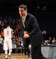 Dec. 22, 2010; Charlottesville, VA, USA; Virginia Cavaliers head coach Tony Bennett talks with the referee during the game against the Virginia Cavaliers at the John Paul Jones Arena. Mandatory Credit: Andrew Shurtleff
