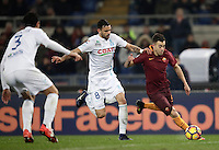 Calcio, Serie A: Roma vs ChievoVerona. Roma, stadio Olimpico, 22 settembre 2016.<br /> Roma&rsquo;s Stephan El Shaarawy, right, is challenged by Chievo Verona's Ivan Radovanovic, center, during the Italian Serie A football match between Roma and Chievo Verona, at Rome's Olympic stadium, 22 December 2016.<br /> UPDATE IMAGES PRESS/Isabella Bonotto
