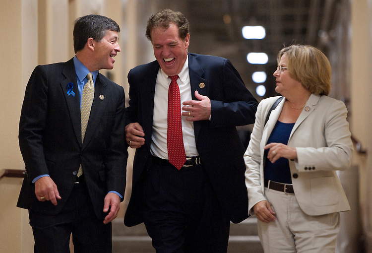 UNITED STATES - JULY 25: From left, House Republican Conference Chairman Jeb Hensarling, R-Texas, left, Rep. Phil Gingrey, R-Ga., and House Foreign Affairs chairwoman Ileana Ros-Lehtinen, R-Fla., arrive for a meeting of the House Republican Conference in the basement of the U.S. Capitol on Monday, July 25, 2011. (Photo By Bill Clark/Roll Call)