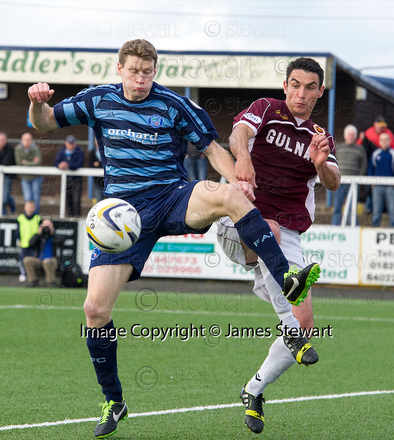 Forfar's Darren Dods and Stenny's Ross McMillan challenge for the ball.