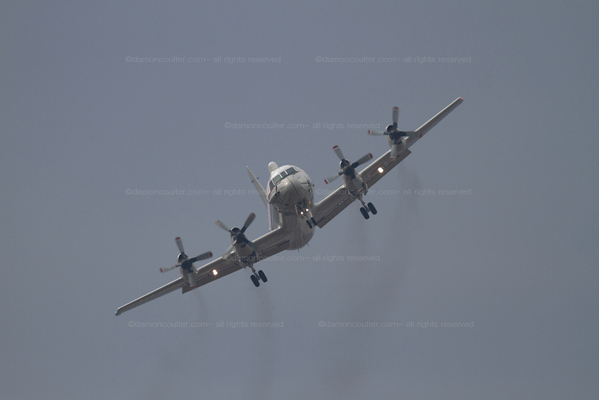 A Lockheed (Kawasaki) UP-3C Orion Maritime reconnaissance aircraft, with the Air development Squadron 51 based in Atsugi, Air base in Kanagawa Japan. Tuesday December 13th 2016. This is the only aircraft in the Japanese armed forces that carries the AIRBOSS (Advanced Infrared Ballistic Missile Sensor System) .