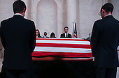 United States President Barack Obama (3L) and First Lady Michelle Obama (3R)  pay their respects to US Supreme Court Justice Anthony Scalia, in front of the casket bearing his body, in the Great Hall of the US Supreme Court, Washington, DC, February 17, 2016.  Anthony Scalia died February 13, 2016, at age 79, during a hunting trip in West Texas. <br /> Credit: Aude Guerrucci / Pool via CNP