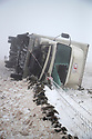 03/03/18<br /> <br /> Commission Fea0081816 Assigned<br /> A lorry is photographed lying on its side after ice, snow and high winds close the A53 near Flash in the Derbyshire Peak District. (Condition of driver is unknown).<br />   <br /> All Rights Reserved F Stop Press Ltd. +44 (0)1335 344240 +44 (0)7765 242650  www.fstoppress.com